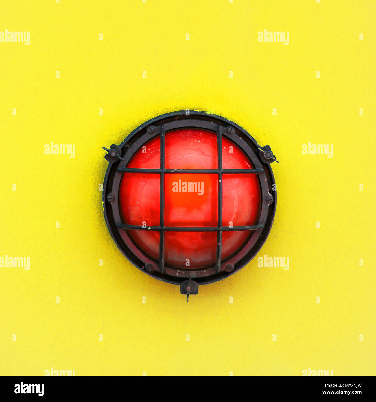 Red alert bulkhead light fixed to a painted yellow orange colour ...