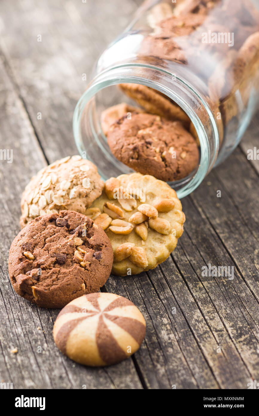 Different types of sweet cookies in jar. - Stock Image