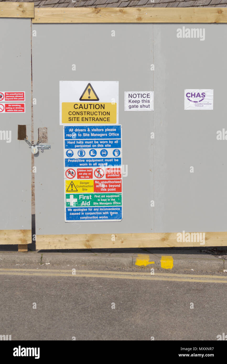Porthcawl, Mid Glamorgan, Wales, UK. 14th April 2018. UK. UK Weather. Health and Safety signs on the construction site, building site by Porthcawl sea - Stock Image