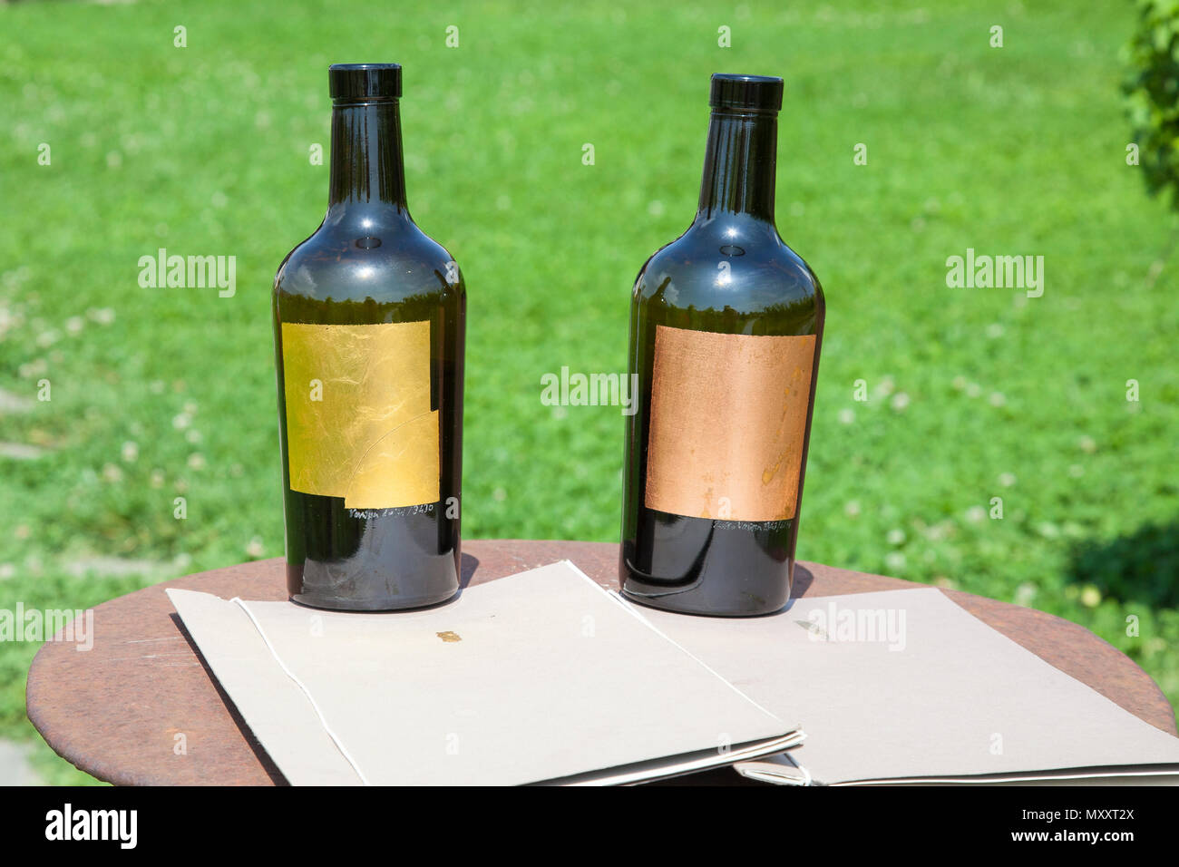 Venissa wine bottles at their winery on Mazzorbo Island, Venice, Veneto, Italy. Made from Murano glass with hand beaten Venetian gold leaf - Stock Image