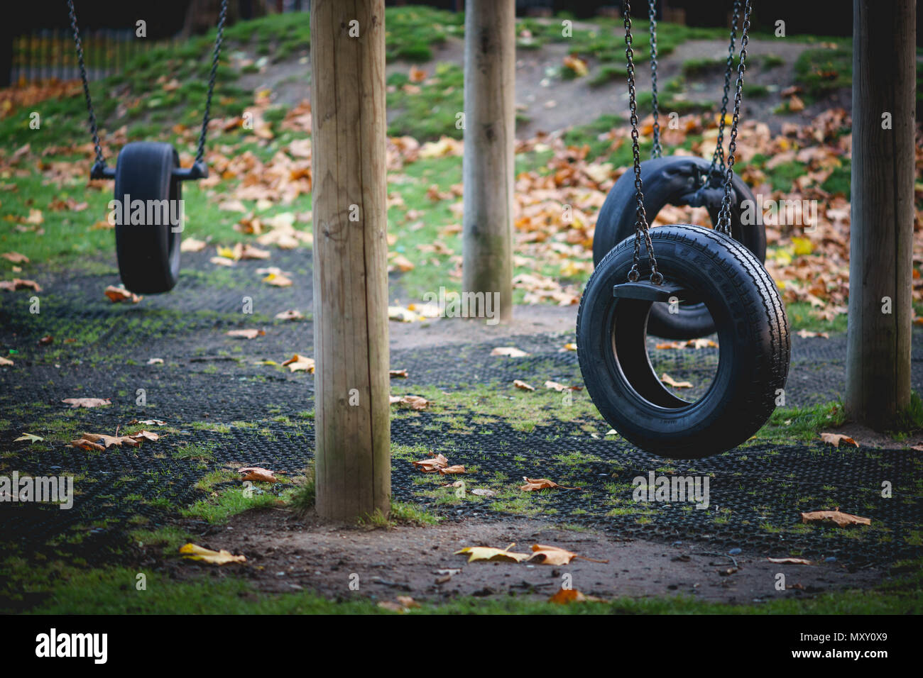 London, UK - October 2017. Empty tyre swings in the playground of Hilly Fields Park at Fall. The park is situated in Lewisham. - Stock Image