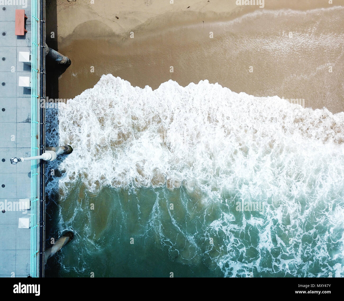 Waves Crashing under the Manhattan Beach Pier - Stock Image