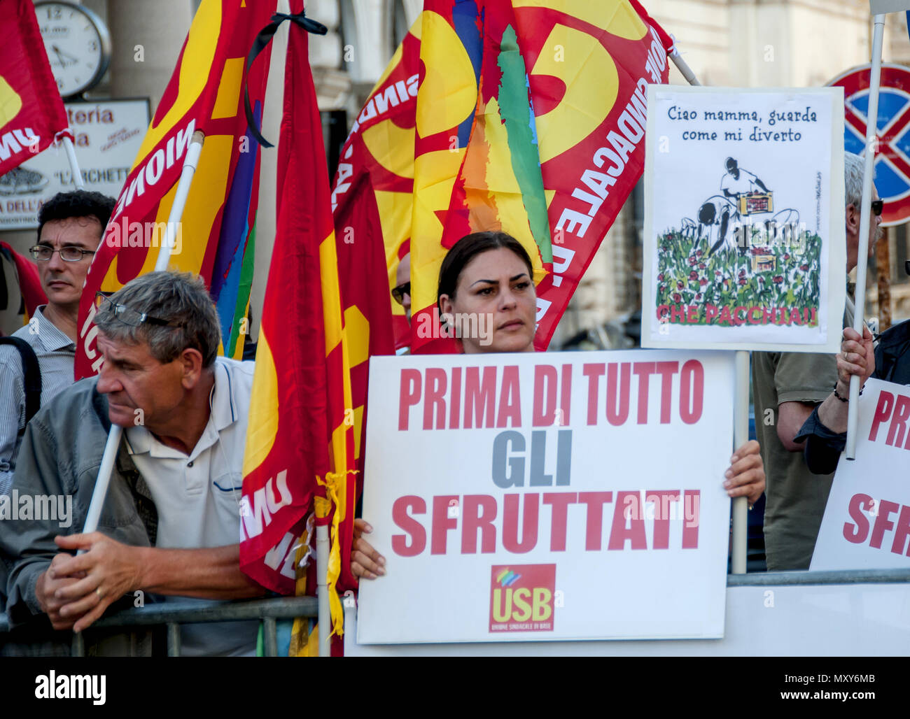 Protest in front of the Prefecture in Rome of the Usb union, the same union that was registered Soumayla Sacko, the 29-year-old Malian laborer killed in the countryside of Vibo Valentia, in Calabria while helping fellow countrymen to recover sheet metal pieces or an abandoned factory to raise shacks where to rest after 12 hours of work in the fields. The union denounces the climate of intolerance fed excessively during the election campaign. The first statements by Matteo Salvini, the current Minister of the Interior, towards the migrants were: 'the pacchus is over'. (Photo by Patrizia Cortell - Stock Image