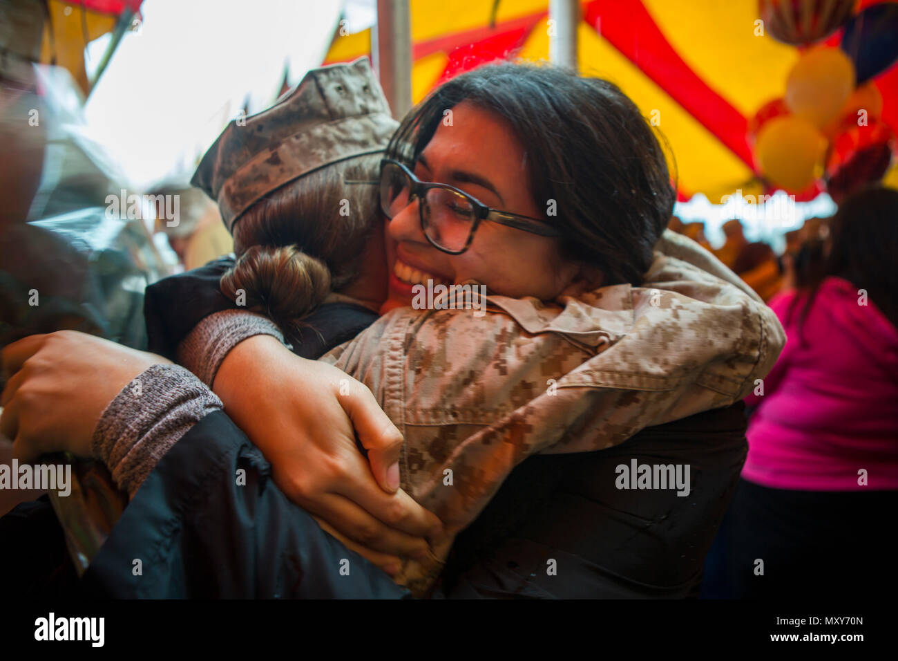 Friends and family of Marines and Sailors with Special Purpose Marine Air-Ground Task Force-Crisis Response-Central Command wait for their return from deployment at Marine Corps Base Camp Pendleton, Calif., Dec. 16, 2016. Stock Photo
