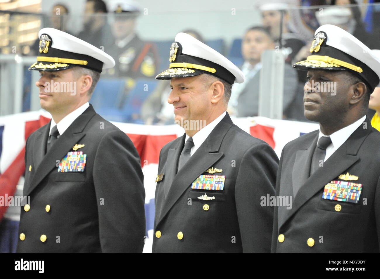 161216-N-CM124-287  GREAT LAKES, Ill. (Dec. 16, 2016) Chief of Naval Personnel Robert P. Burke center, joins Capt. Mike Garrick, commanding officer, Recruit Training Command, left, and Rear Adm. Stephen C. Evans, commander, Naval Service Training Command, on the drill deck to congratulate recruit award winners at the Pass-In-Review ceremony Dec. 16 at Midway Ceremony Drill Hall, Recruit Training Command. Burke served as the ceremony's reviewing officer where just over 940 recruits graduated from the Navy's only boot camp.  (U.S. Navy photo by Susan Krawczyk/Released). - Stock Image