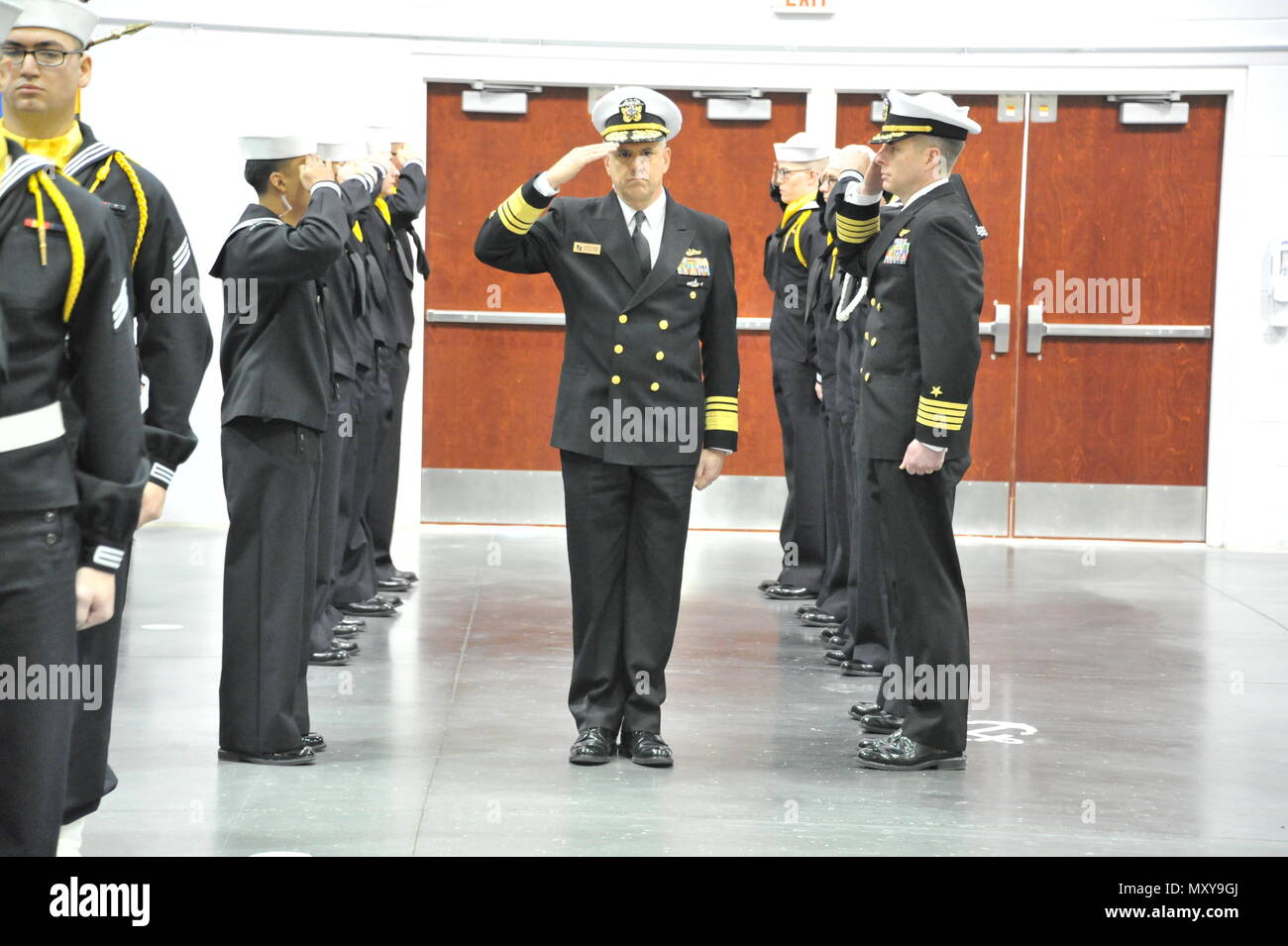 161216-N-CM124-129  GREAT LAKES, Ill. (Dec. 16, 2016) Chief of Naval Personnel Robert P. Burke is introduced to the guests at the Pass-In-Review ceremony Dec. 16 at Midway Ceremony Drill Hall, Recruit Training Command. Burke served as the ceremony's reviewing officer where just over 940 recruits graduated from the Navy's only boot camp.  (U.S. Navy photo by Susan Krawczyk/Released). - Stock Image