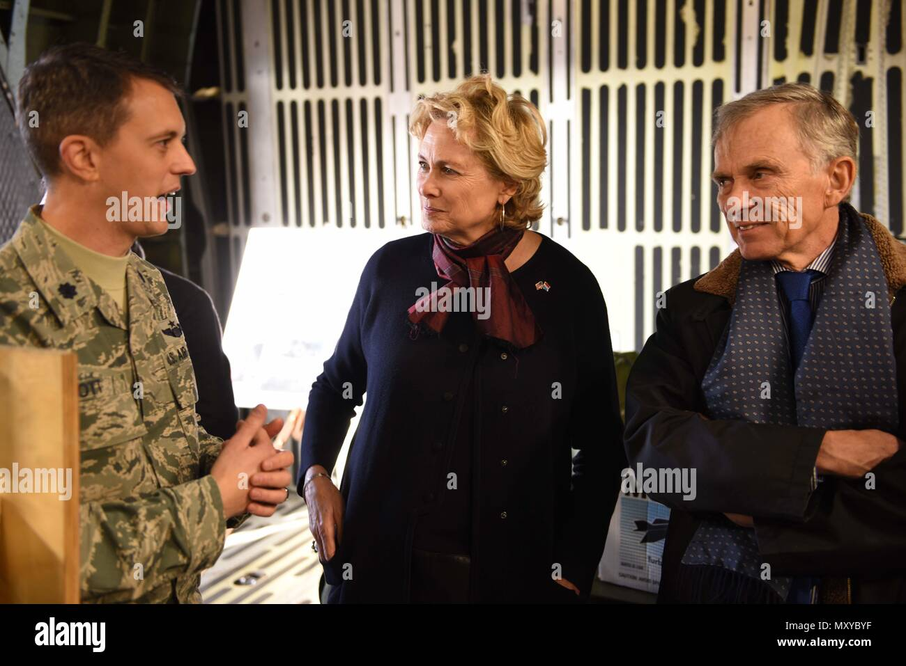 David McKean, right, U.S. Ambassador to Luxembourg, and his wife, Kathleen Kaye, middle, receive a briefing from Lt. Col. Chris Ott, right, 726th Air Mobility Squadron director of operations, inside a C-5M Galaxy about the aircraft's proficiency and usefulness at Spangdahlem Air Base, Germany, Dec. 20, 2016. This was McKean's first visit to the base, during which wing leadership briefed him about the Saber Nation mission and different capabilities. McKean was sworn in as ambassador in March 2016. (U.S. Air Force photo by Senior Airman Joshua R. M. Dewberry) - Stock Image