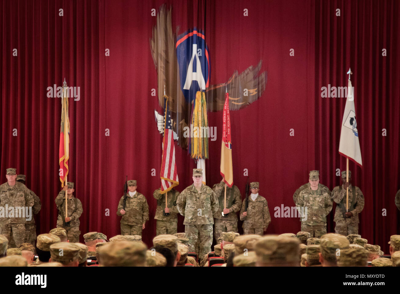 Soldiers of the 451st Sustainment Command (Expeditionary) prepare to case their color and guideon during their transfer of authority ceremony to the 316th ESC at Camp Arifjan, Kuwait, Dec. 23, 2016. (U.S. Army Photo by Staff Sgt. Dalton Smith) - Stock Image