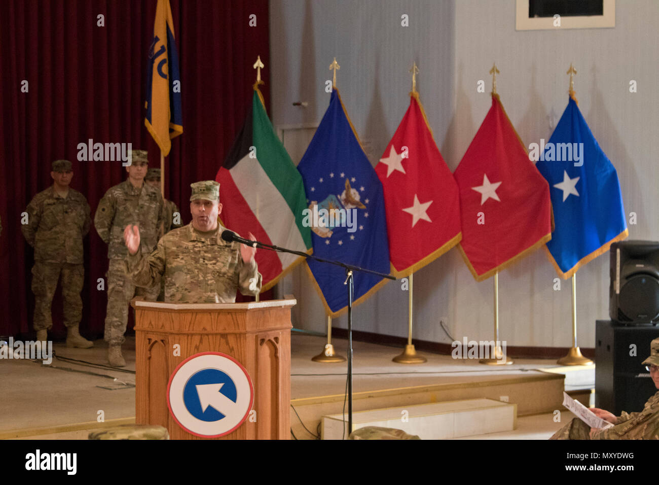 1st Sustainment Command (Theater) Commander Maj. Gen. Paul C. Hurley Jr., U.S. Army Central deputy commanding general, gives remarks during the 451st Sustainment Command (Expeditionary) and 316th ESC transfer of authority ceremony at Camp Arifjan, Kuwait, Dec. 23, 2016. (U.S. Army Photo by Staff Sgt. Dalton Smith) - Stock Image