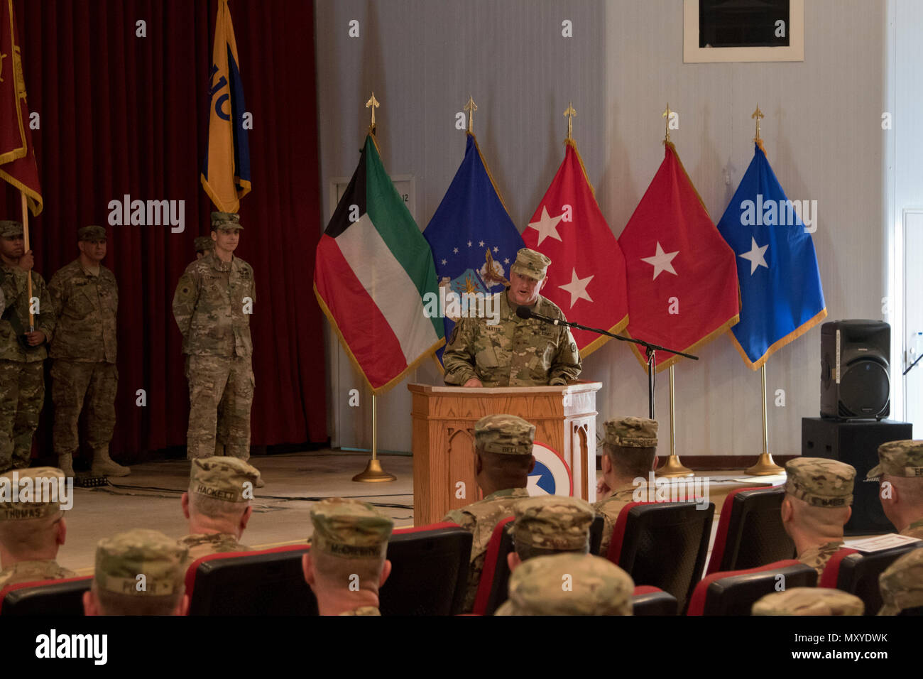 Brig. Gen. Robert Harter, the commanding general of the 316th Sustainment Command (Expeditionary), gives remarks during the 451st ESC and 316th ESC transfer of authority ceremony at Camp Arifjan, Kuwait, Dec. 23, 2016. (U.S. Army Photo by Staff Sgt. Dalton Smith) - Stock Image