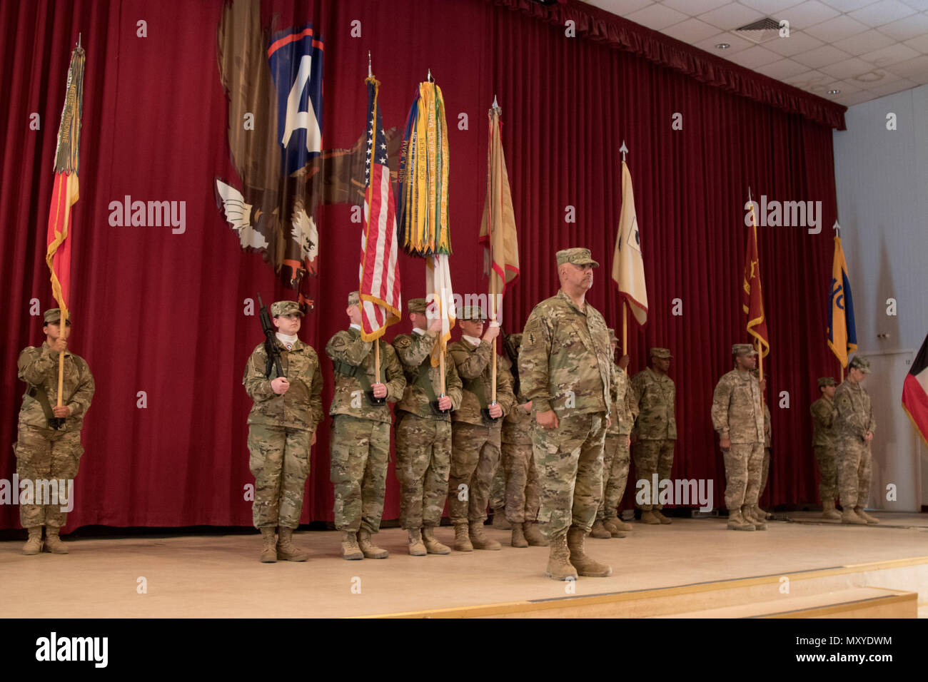 Col. Curtis Henry, the chief of staff of the 316th Sustainment Command (Expeditionary), calls a color guard to attention during a transfer of authority ceremony at Camp Arifjan, Kuwait, Dec. 23, 2016. (U.S. Army Photo by Staff Sgt. Dalton Smith) - Stock Image