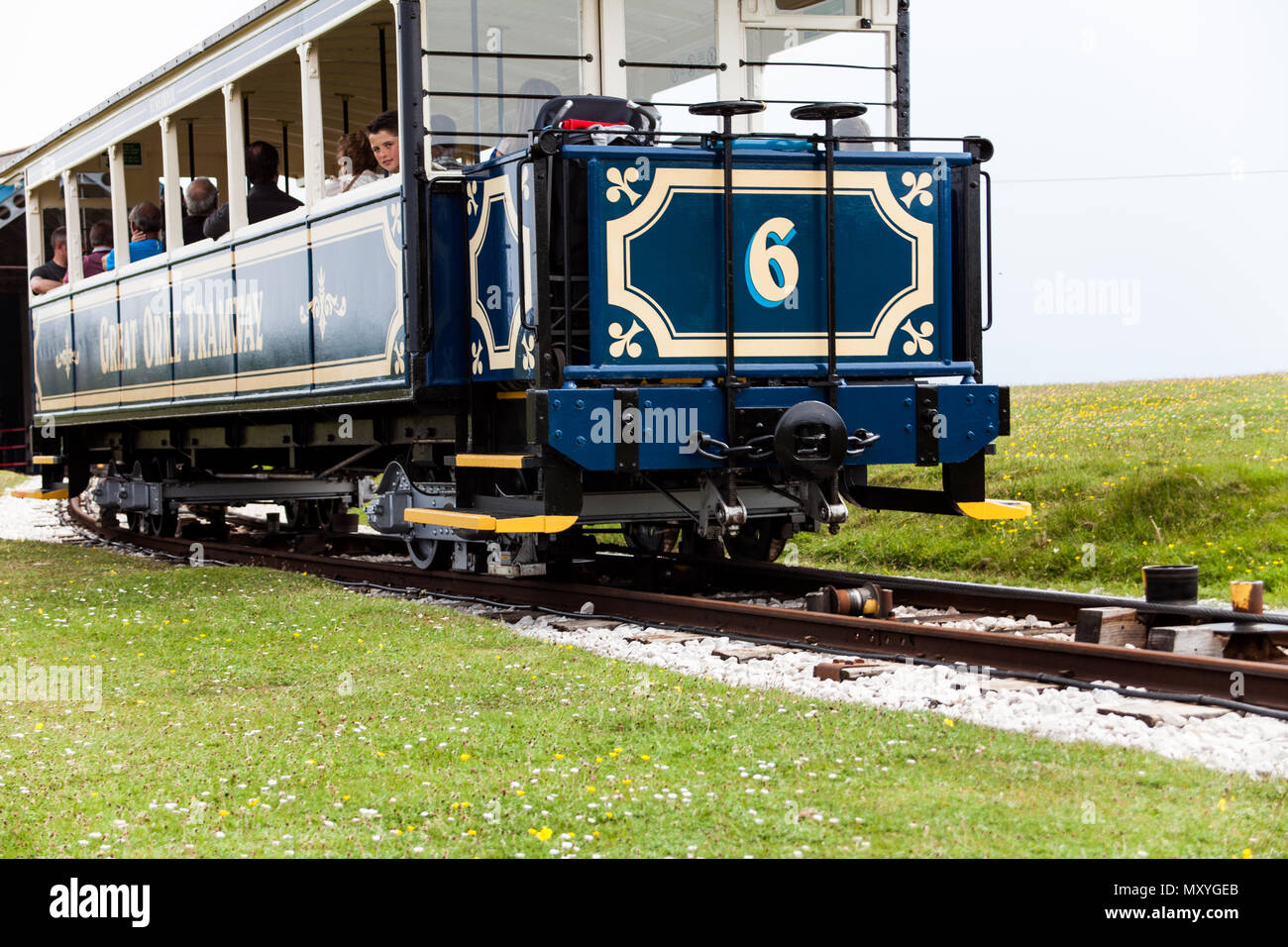 A fascinating journey on the vintage blue funicular tramway. nature sightseeing during the trip on tram. The spectacular ride to the station on the ca - Stock Image