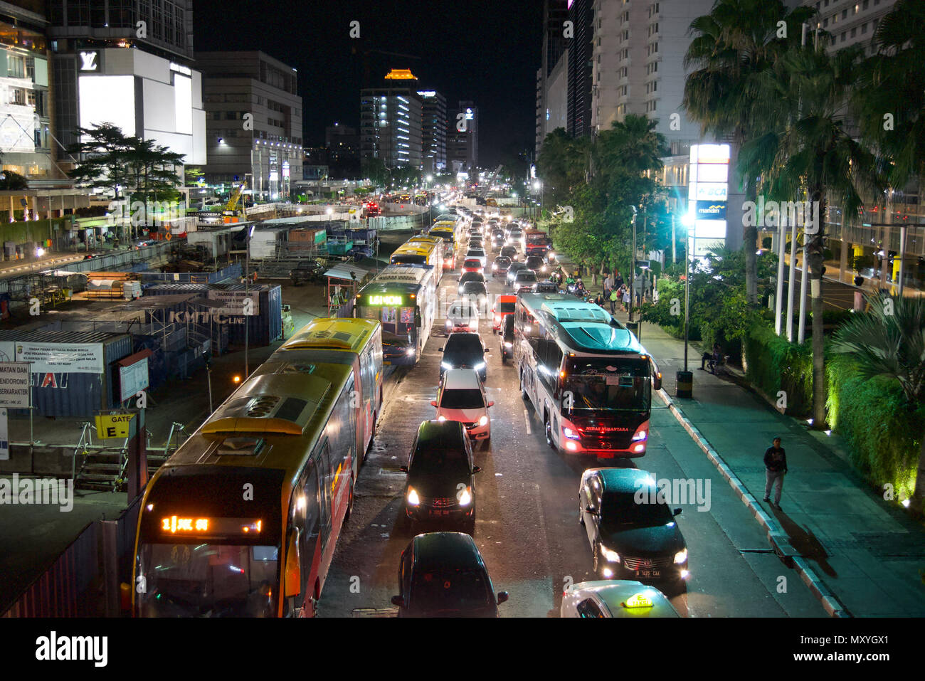Traffic congestion, MRT construction work area, and footpath on the roadside of Thamrin Street, Jakarta, Indonesia. - Stock Image
