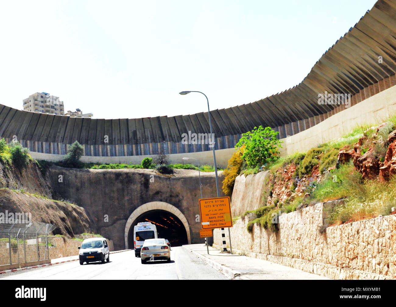 The ' Tunnel road' built by Israel with wall protection in Gush Etzion, West Bank. - Stock Image