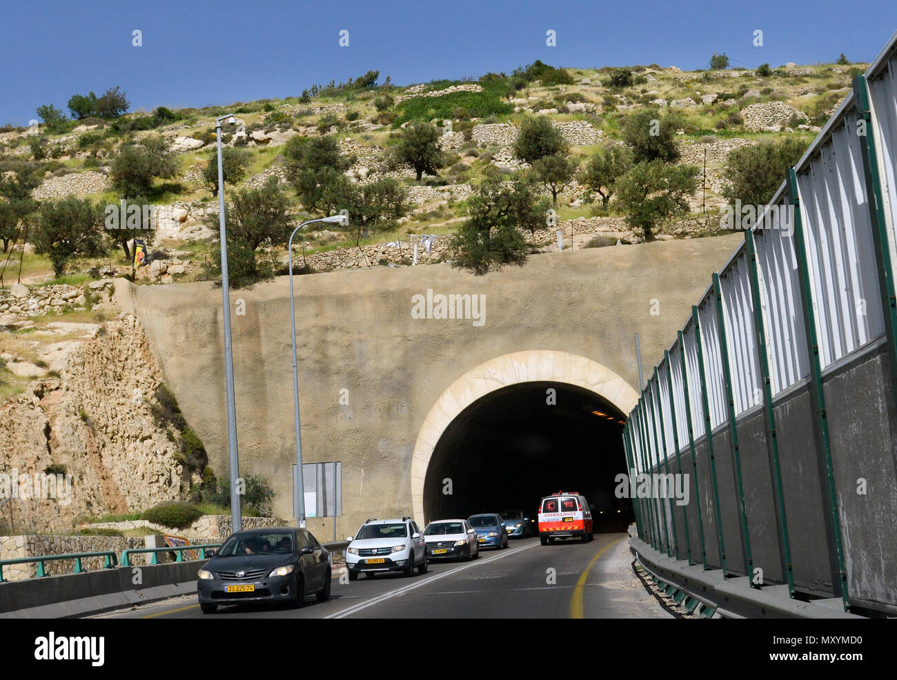 Israeli highway with wall protection in Gush Etzion, West Bank. - Stock Image
