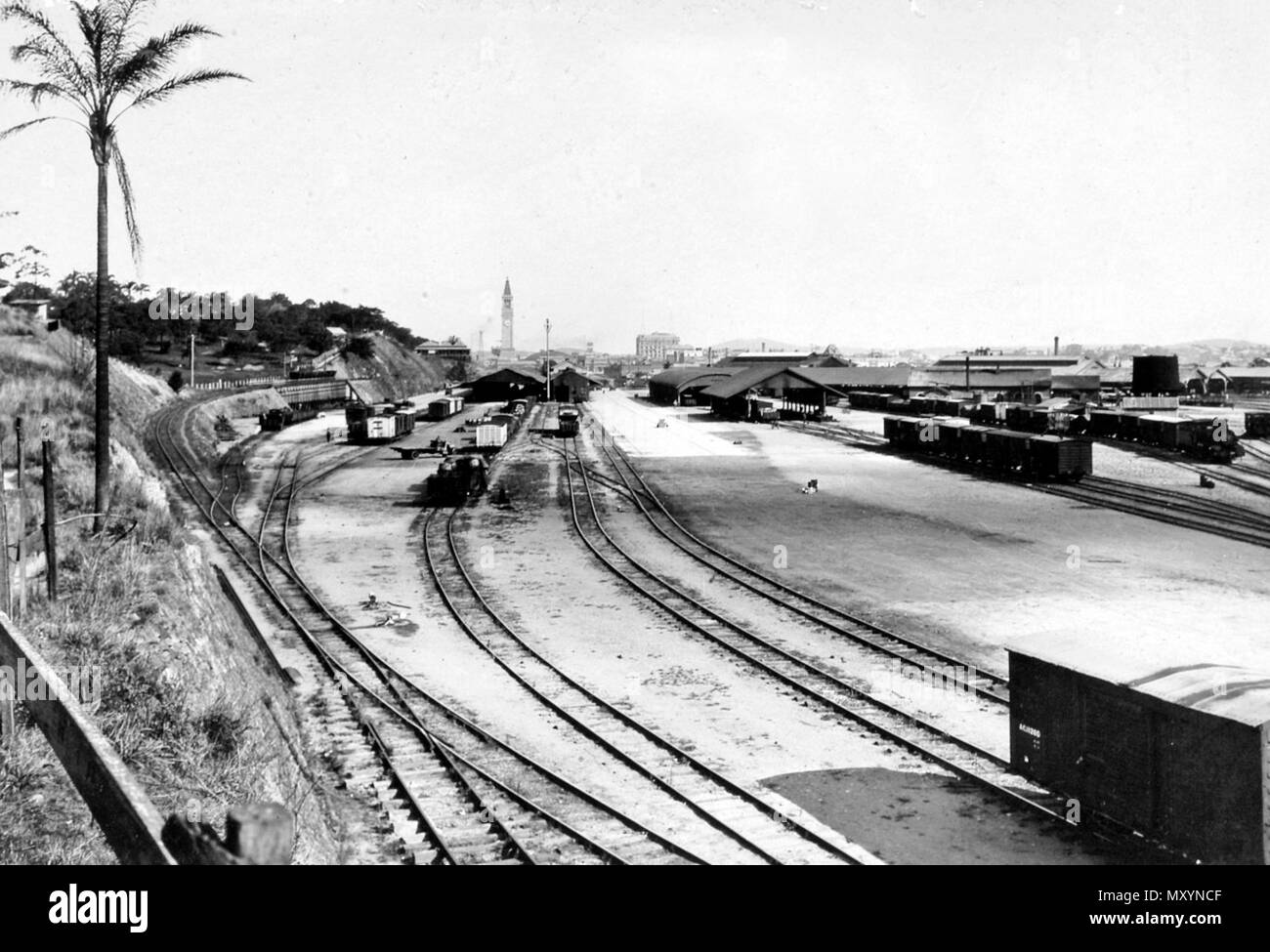 New Goods Yard at Roma Street Railway Station, c 1936. The Courier Mail Sat 6 Oct 1934  TRAINS COLLIDE AT ROMA STREET Engine Derailed Driver and Friemen Suspended  With a crash that could be heard for hundreds of yards, a goods train and an empty passenger train came into collision at the Southern end of the Roma Street goods yards early yesterday morning. The engine of the passenger train was badly derailed, its front portion being extensively damaged, and several waggons on the goods train received slight damage. No one was injured.   The collision occurred about 7.30am, the trains involved  - Stock Image