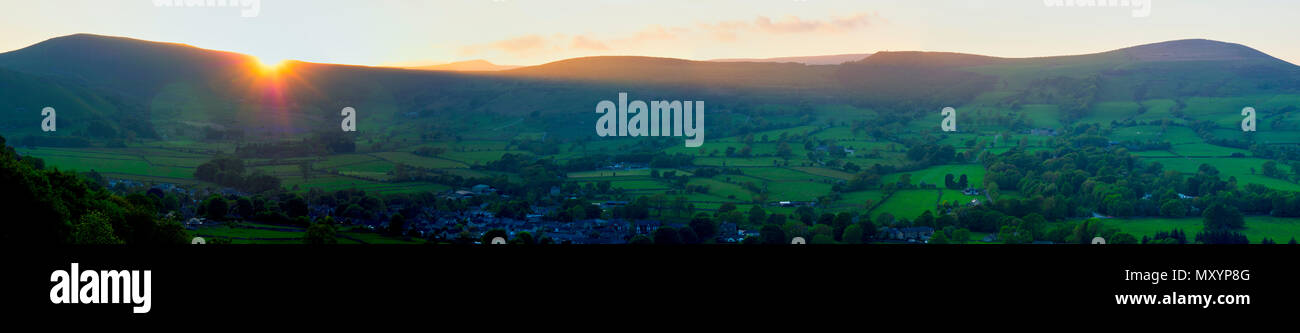panoramic sunset picture of walkers on The Great Ridge Night Light in the Peak District National Park at the start of the BMC's Mend Our Mountains - Stock Image