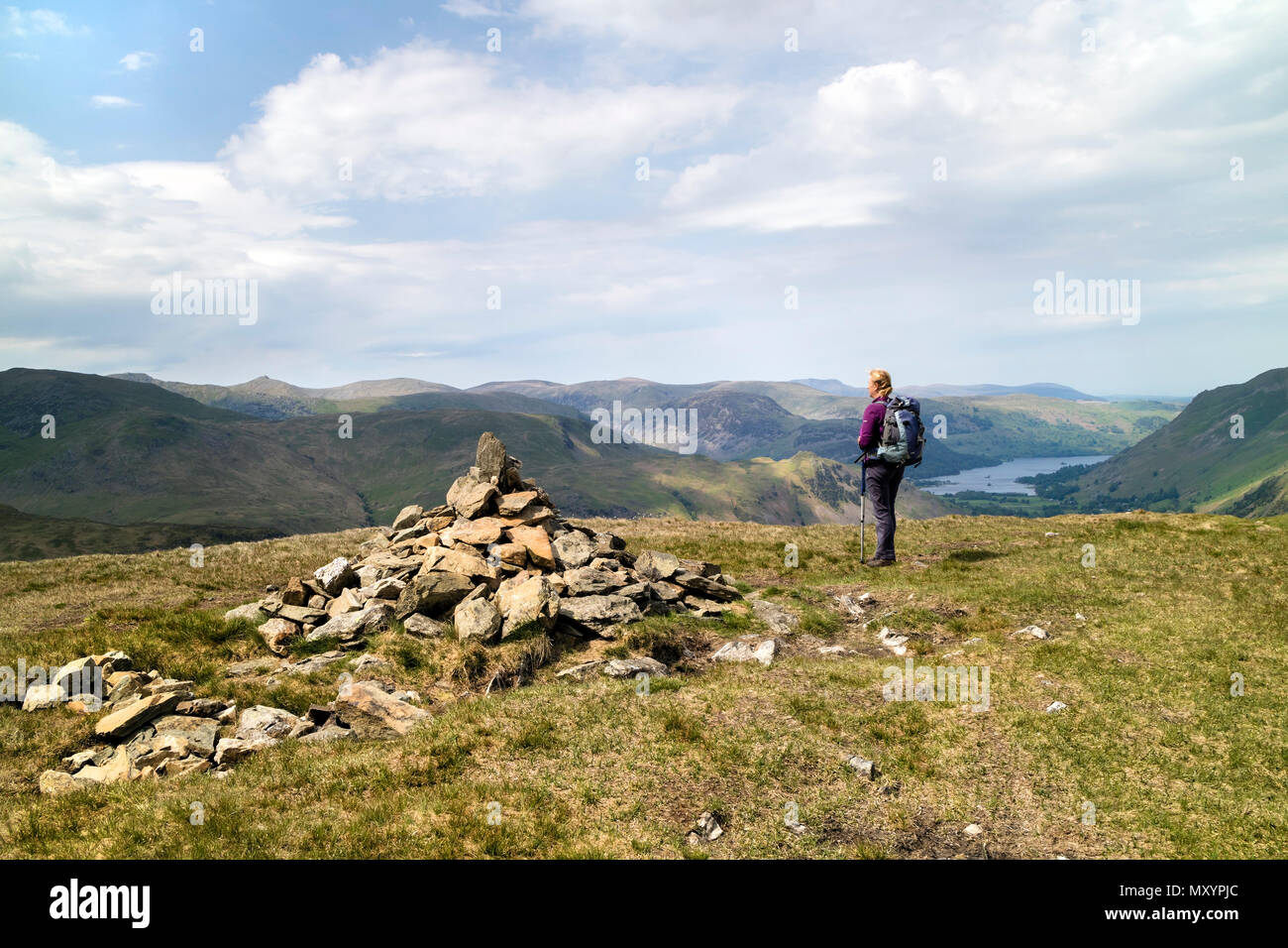 Walker Enjoying the View Northwest Over Patterdale from the Summit Cairn of Hartsop Dodd, Lake District Cumbria, UK. - Stock Image