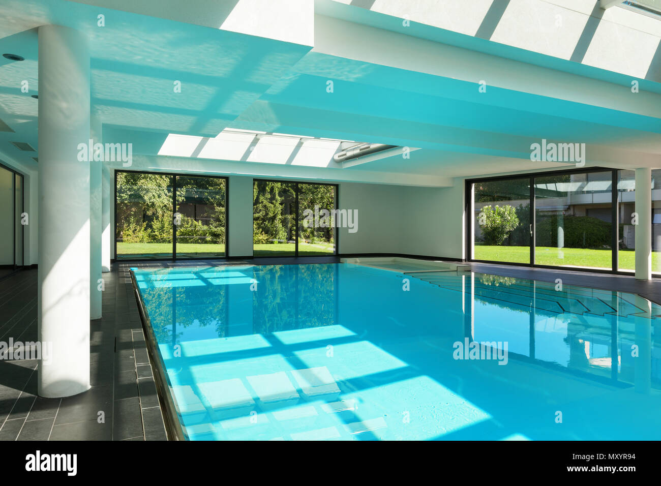 indoor swimming pool of a modern house with spa Stock Photo ...