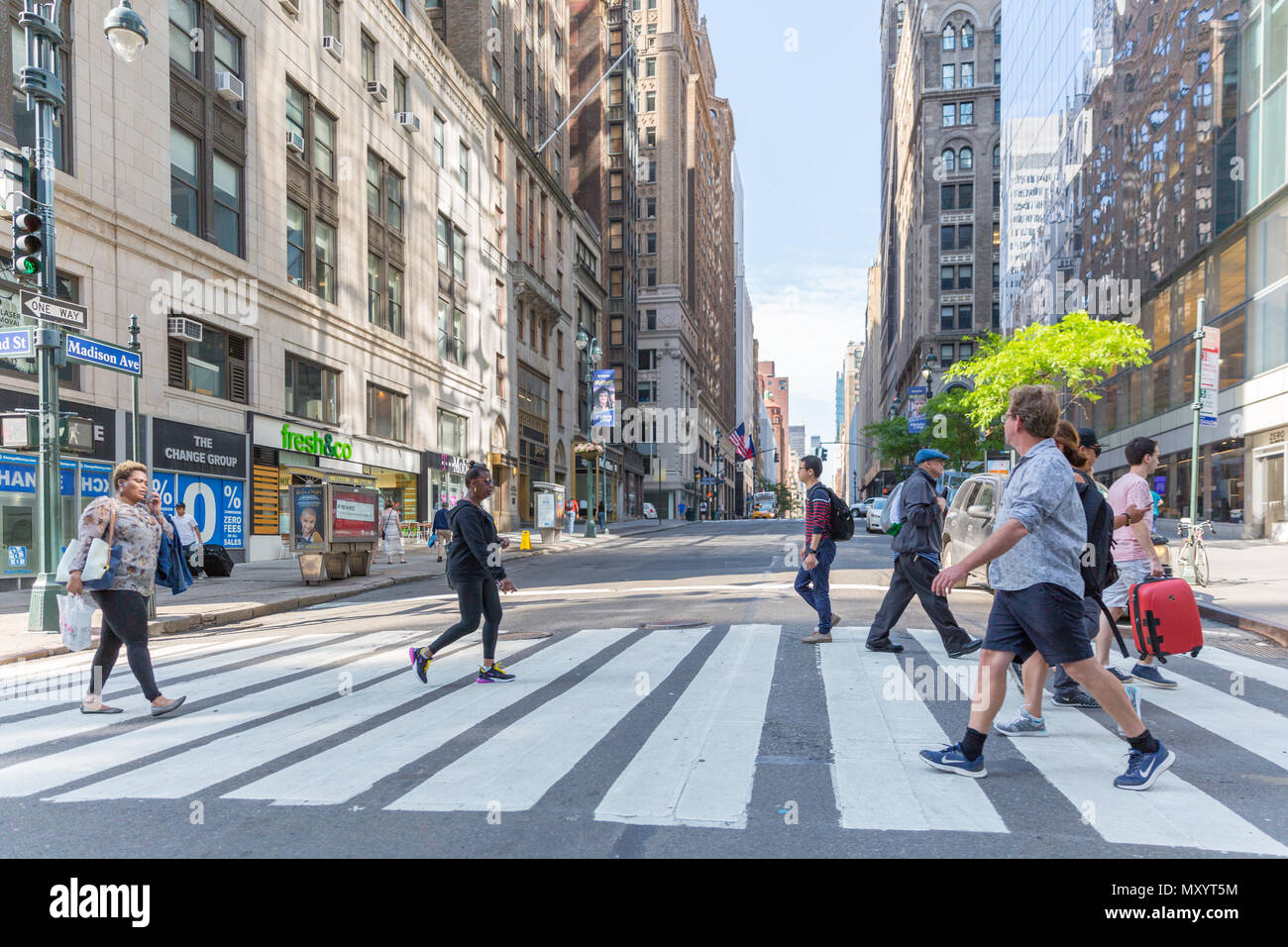New York - June 2, 2018: A view down a busy avenue street, People walk on busy streets - Stock Image
