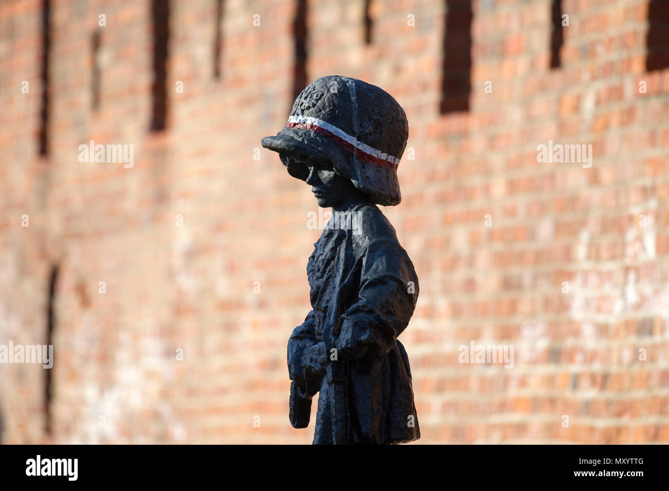 The monument of the Little Insurgent (Pomnik Malego Powstanca) in Warsaw Old Town, Warsaw, Poland. May 12th 2018. The statue is a homage to the child  Stock Photo