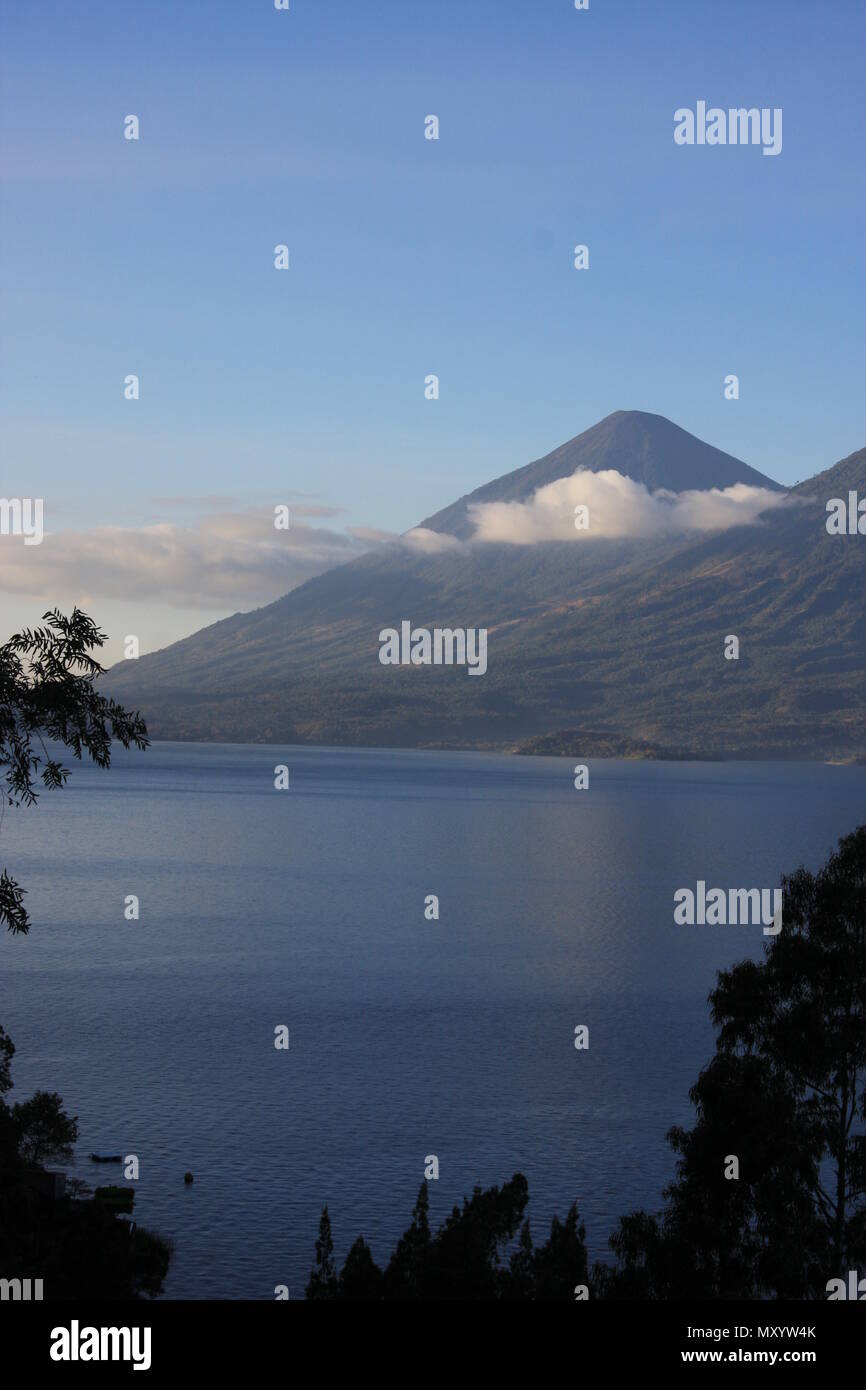Lake Atitlán Guatemala clouds against the mountains just before sunset - Stock Image