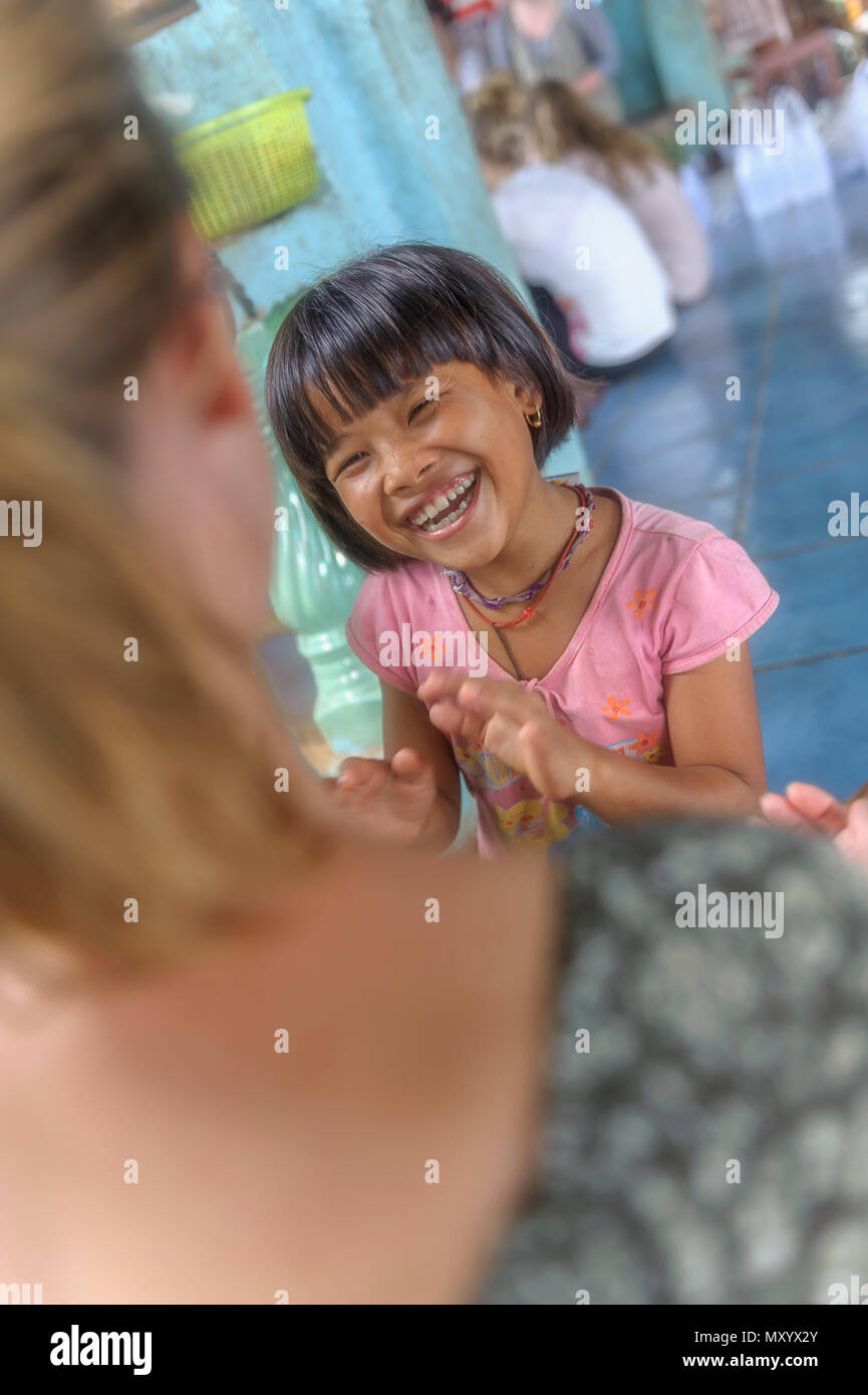 Gap year voluntary holiday or Voluntourism in a orphanage, Thailand - Stock Image