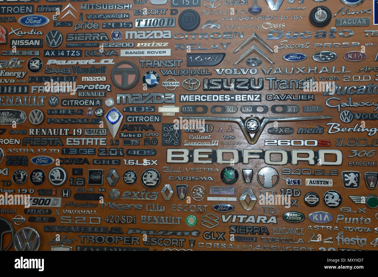 A board with a variety of  car emblems and logos old and new at the Shetland Classic Car show 2018 - Stock Image