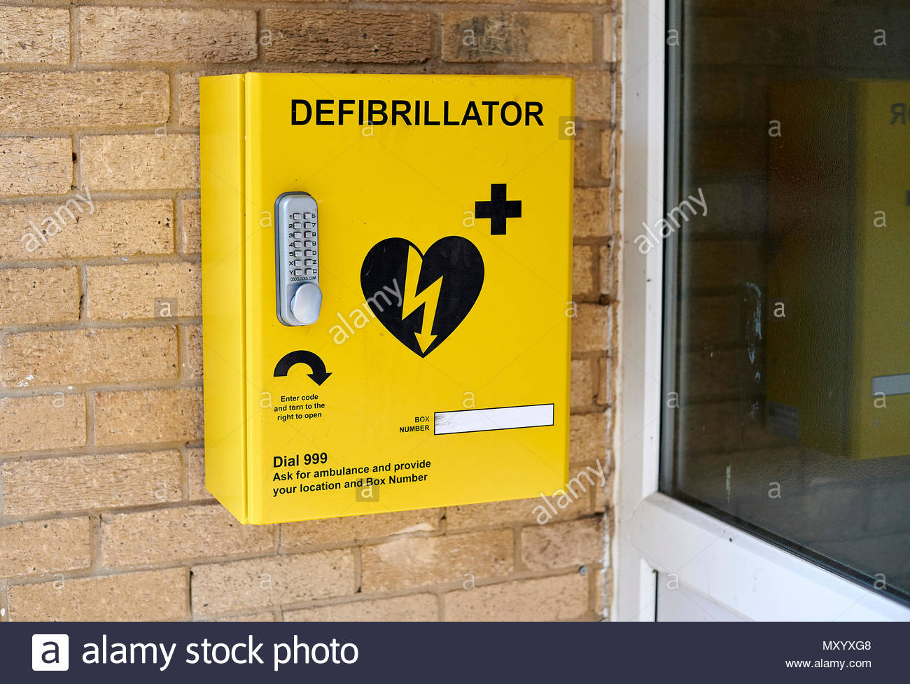 Defibrillator on wall outside a Sports Club in Cotswolds - Stock Image