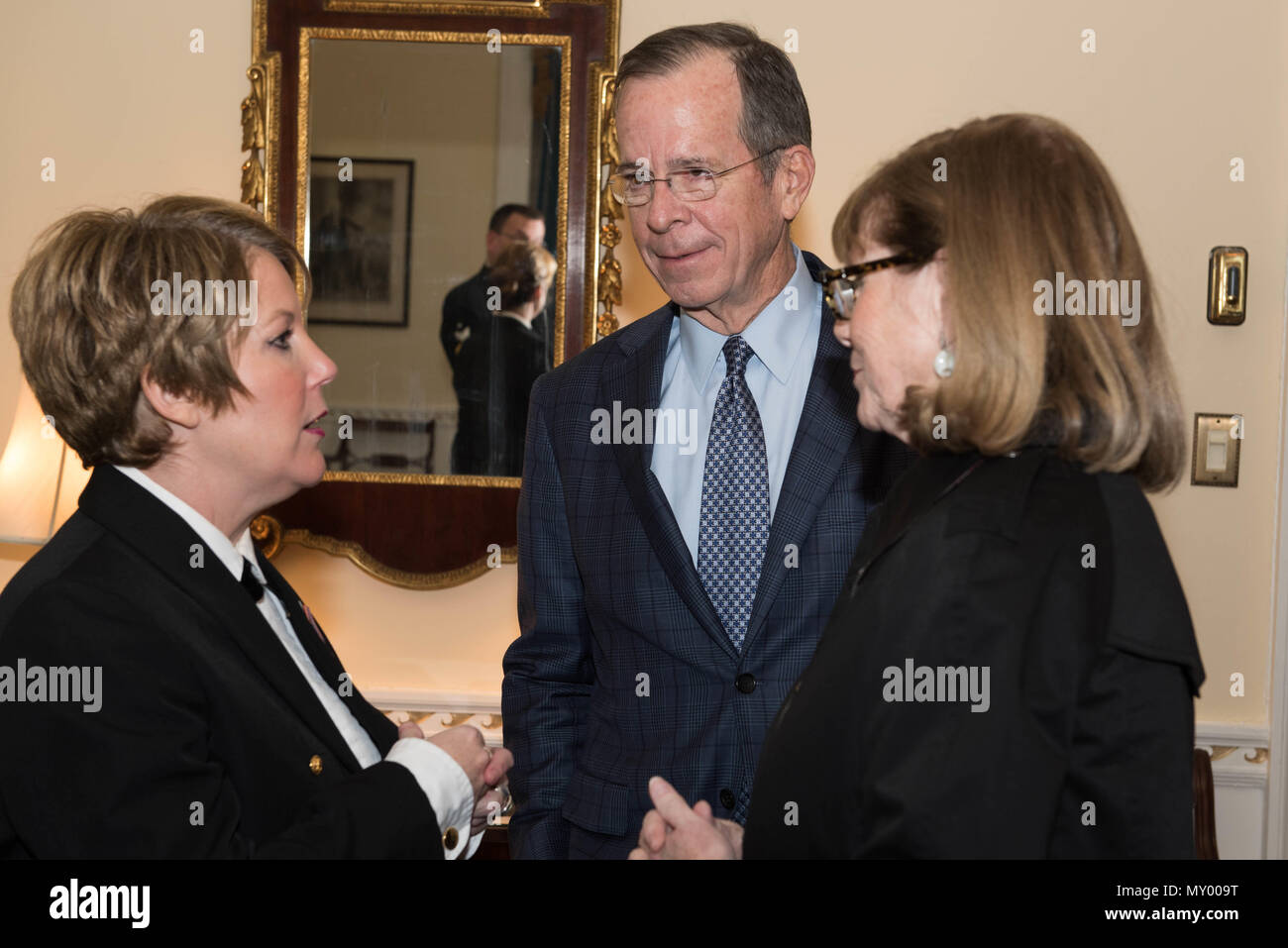 161218-N-HG258-017 WASHINGTON (Dec. 18, 2016) Chief Petty Officer Shana Sullivan, left, meets former Chairman of the Joint Chiefs of Staff, Adm. Michael Mullen, right, backstage after the Sunday afternoon Navy Band Holiday Concert held at DAR Constitiution Hall in Washington, D.C. The Navy Band hosted thousands of people from the Washington area as well as hundreds of senior Navy and government officials during its three annual holiday concerts.  (U.S. Navy photo by Senior Chief Petty Officer Stephen Hassay/Released) - Stock Image