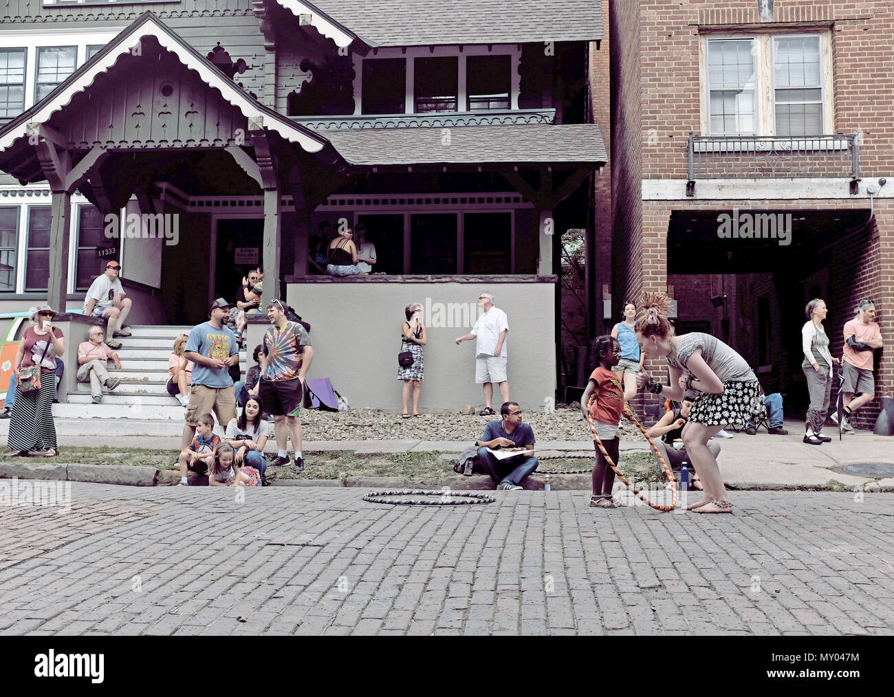 People enjoying a summer afternoon in Cleveland, Ohio, USA at the 2018 annual Hessler Street Fair. - Stock Image