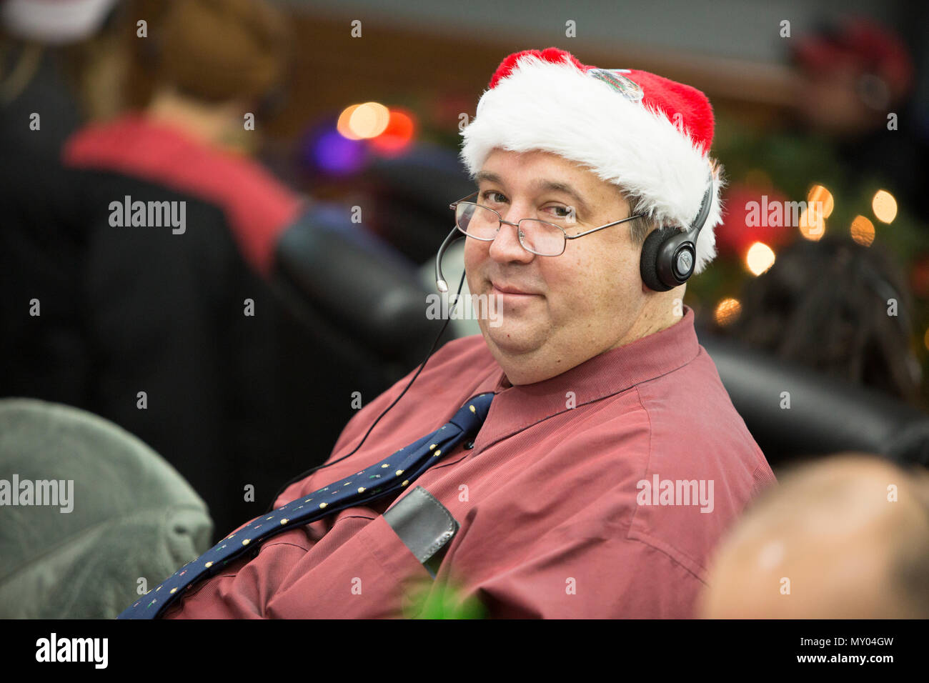Volunteers answer phones during annual NORAD Tracks Santa event on ...