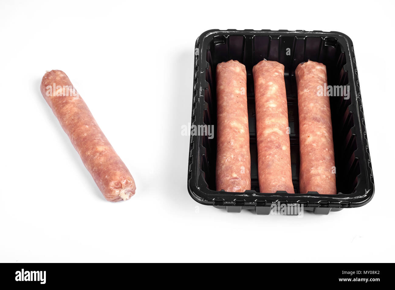 Package of raw sausages isolated on white background - Stock Image