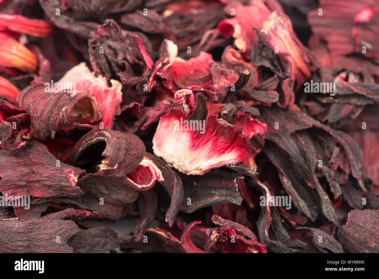Bunch of dry aromatic hibiscus tea closeup - Stock Image