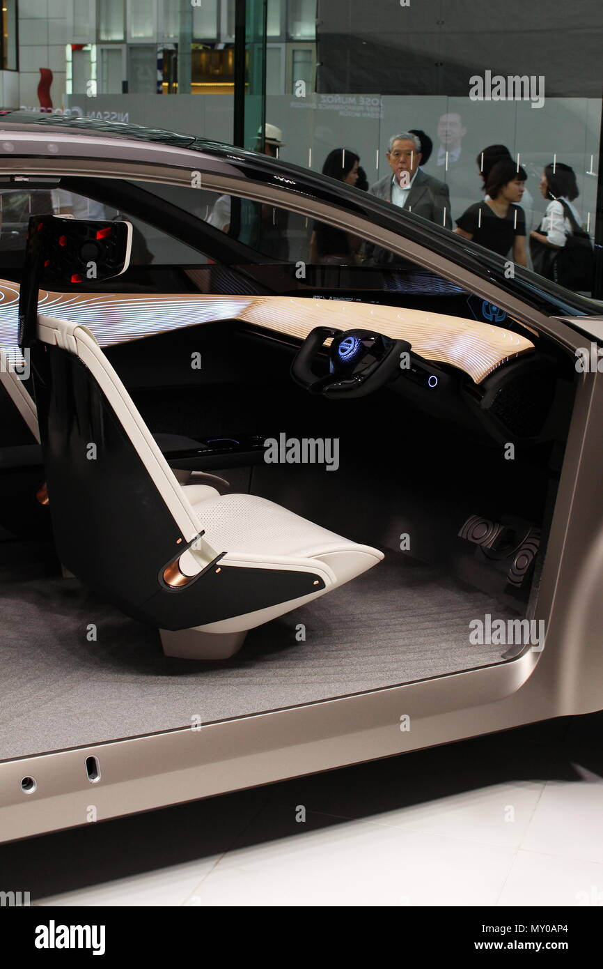 View of a Nissan IMx Kuro electric concept car's front seat and steering wheel. Seen  at Ginza Place's Nissan Crossing showroom in Tokyo.  (6/2018) - Stock Image