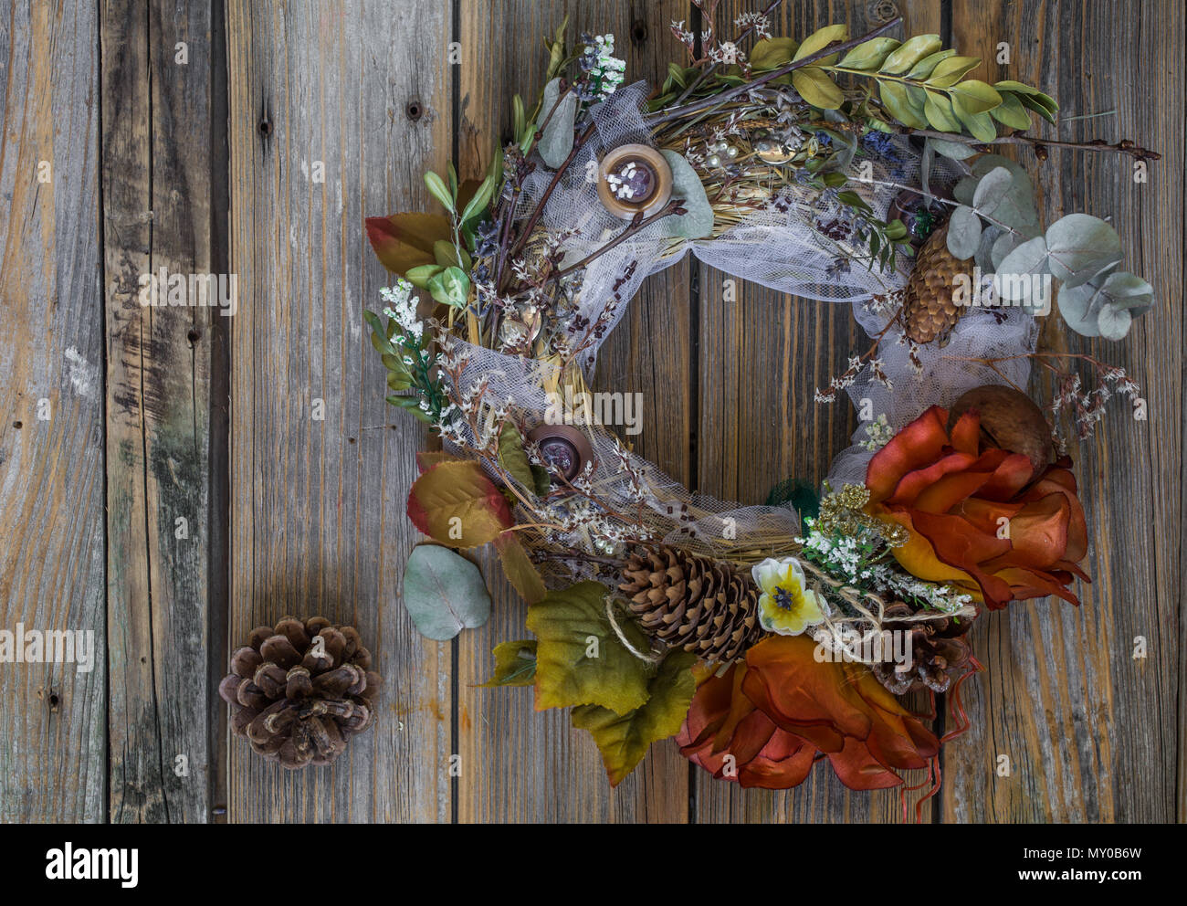 Autumn Wreath On Wooden Background In The Form Of A Circle Decor