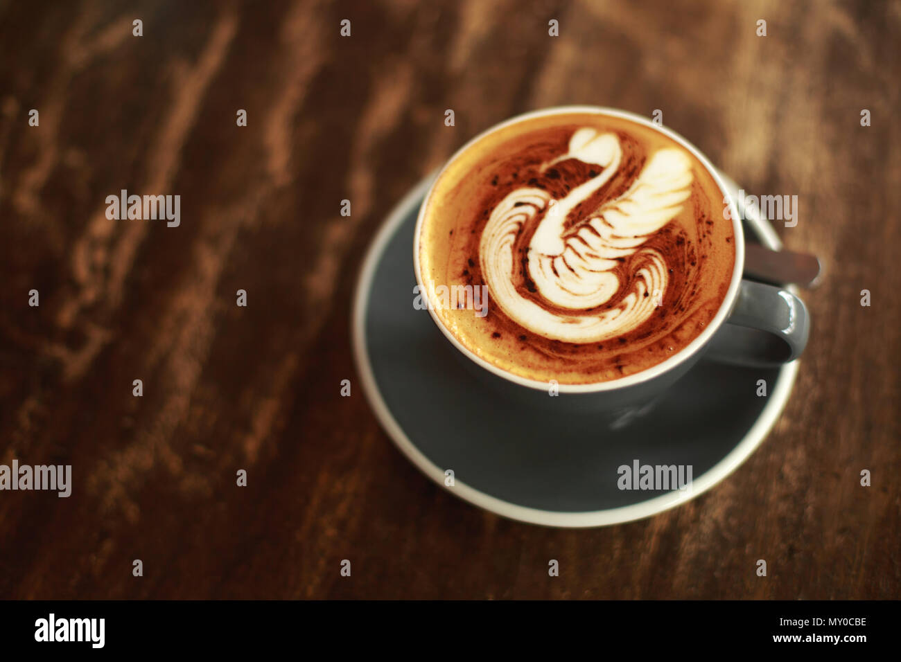 Cup of cappuccino with swan latte art - Stock Image