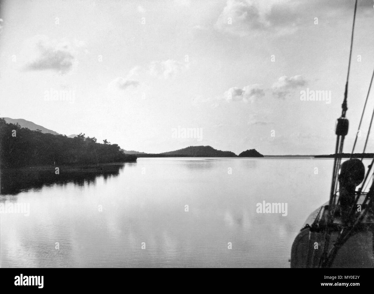 Scene in Hinchinbrook Channel, North Queensland, c 1927. The Week 3 June 1927  TOURIST TRAFFIC. RECORD SEASON. PROMISED. 187592502 )   The tourist traffic In Queensland for this winter gives promise of breaking all records. Officers of the Intelligence and Tourist Bureau report that the traffic to date has exceeded expectations, and visitors are coming from West Australia, South Australia, Tasmania, and New Zealand In large numbers.  The winter attractions of Queensland, particularly the north, orb being more and more recognised. The glories of the Cairns hinterland, of the Barron Falls and th - Stock Image