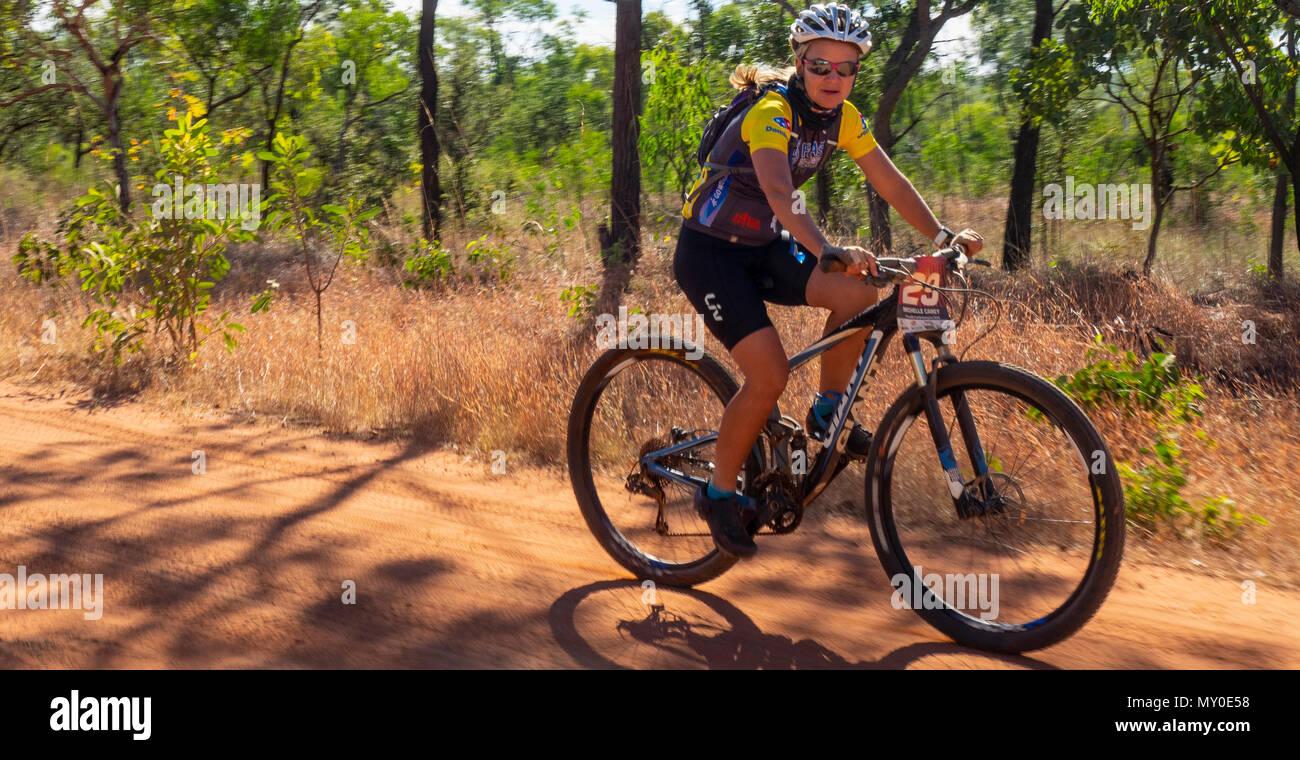 Female cyclist riding a mountain bike in the Gibb Challenge 2018 on the Gibb River Road Kimberley WA Australia Stock Photo