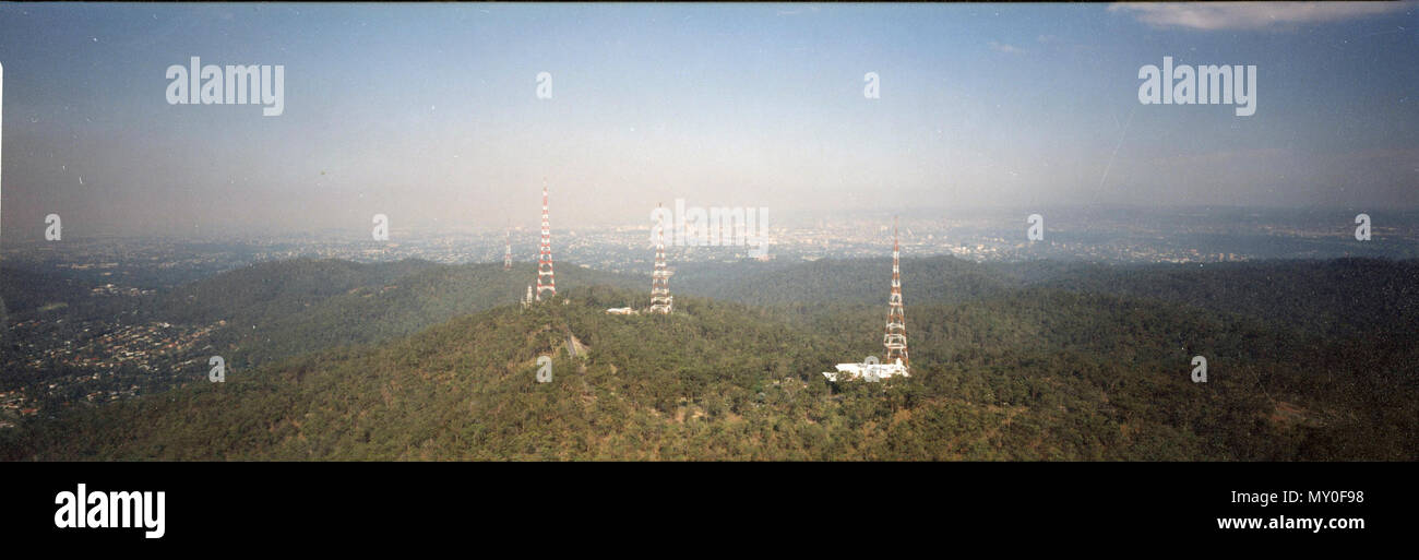 The Towers of Mt Coot-tha, 10 December 1992. On a ridge near the summit on the other side of Mount Coot-tha, are the television transmission towers for the Brisbane television stations and their respective studios; Ten (TVQ-10), Nine (QTQ-9), Seven (BTQ-7). The transmission tower for (ABC Brisbane) is located on the mountain, which also broadcasts television for multicultural station SBS and Brisbane community television channel 31 Digital. Most of the FM Brisbane radio stations also transmit from Mount Coot-tha. - Stock Image