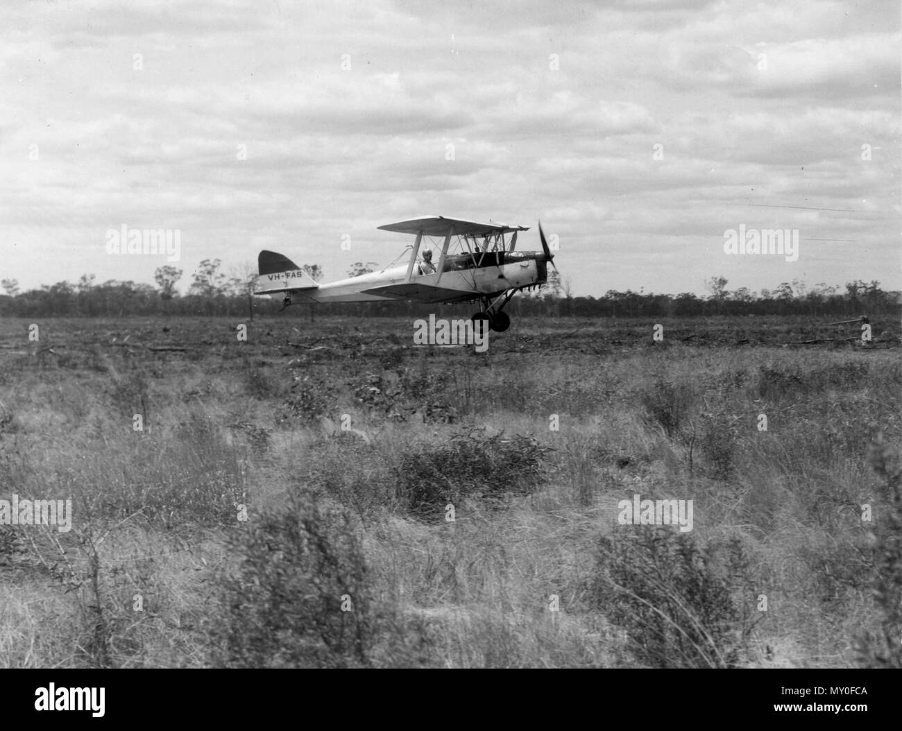 Tiger Moth plane used for for aerial sowing, November 1963. A de Havilland DH.82 Tiger Moth owned by Brown Williams Aviation Ltd was used for aerial seed sowing of the Fitzroy Basin scheme in the early 1960s.  This aircraft started life in the Royal Australian Air Force in 1942. It still flies today with the Royal Aero Club of Western Australia. - Stock Image