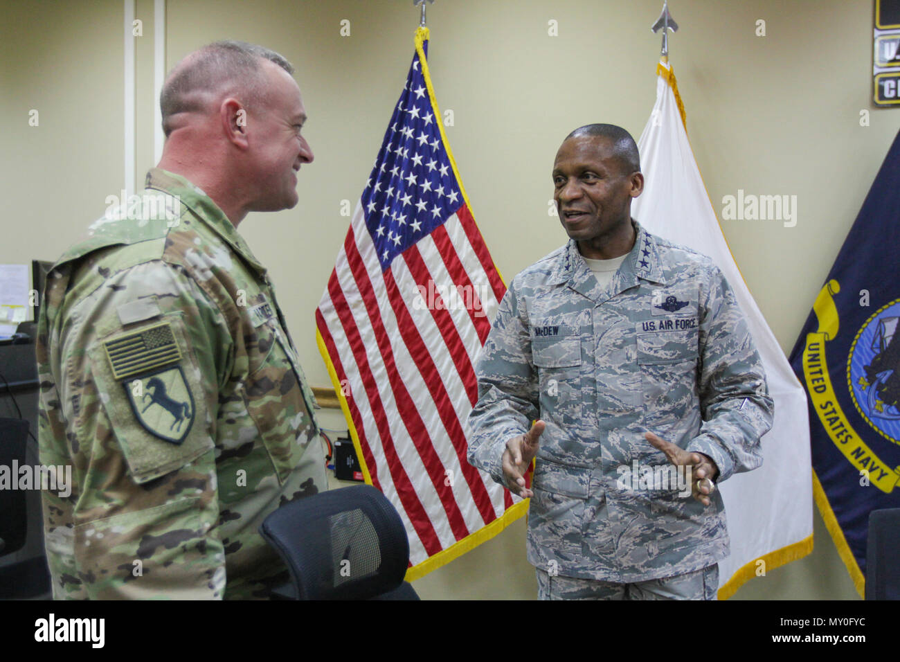 Gen. Darren W. McDew, commanding general of U.S. Transportation Command, (right) speaks with Brig. Gen. Robert D. Harter, commanding general of the 316th Sustainment Command (Expeditionary), an Army Reserve unit based out of Coraopolis, Pa., (left) about transportation and distribution of materials challenges in the U.S. Central Command (CENTCOM) area of responsibility at Camp Arifjan, Kuwait, Dec. 13, 2016. The realignment of joint forces has sped up the process of troops receiving vital supplies in the CENTCOM area of responsibility. (U.S. Army Photo by Staff Sgt. Dalton Smith) - Stock Image