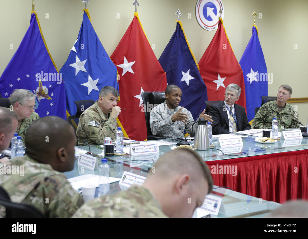 Gen. Darren W. McDew, commanding general of U.S. Transportation Command, speaks with key leaders of joint logistics commands about transportation and distribution of materials challenges in the U.S. Central Command (CENTCOM) area of responsibility at Camp Arifjan, Kuwait, Dec. 13, 2016. The realignment of joint forces has sped up the process of troops receiving vital supplies in the CENTCOM area of responsibility. (U.S. Army Photo by Staff Sgt. Dalton Smith) - Stock Image