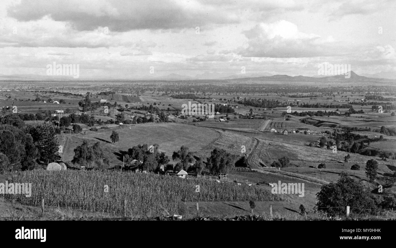 Farm lands, looking south from Tallegalla, Rosewood district, May 1939. The Telegraph 16 March 1939  ROSEWOOD  Approval has been given for a Light Horse training centre lo be opened at Rosewood under Lieutenant A. N. Munro. of Lowood. Five new recruits have enlisted with 'he infantry platoon.  The death occurred recently of Mr. William Yarrow, the 25-year-old son of Mr. S. Yarrow, of Rosewood and the late Mr. William Yarrow. He had been ill for two years. The funeral took place to Tallegalla cemetery.  The death has occurred of Mr. Frederick Strudwlck at the home of his daughter, Mrs. W. Clayt - Stock Image