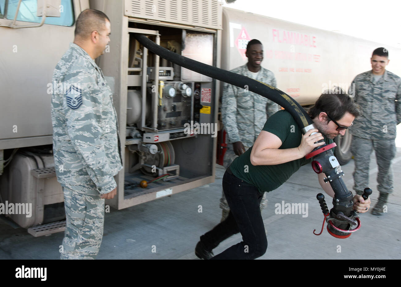 Guitarist ryan truso pulls a hose from a fuel truck during a morale a hose from a fuel truck during a morale visit at al udeid air base qatar dec 30 2016 truso is the guitarist for country music artist david nail m4hsunfo