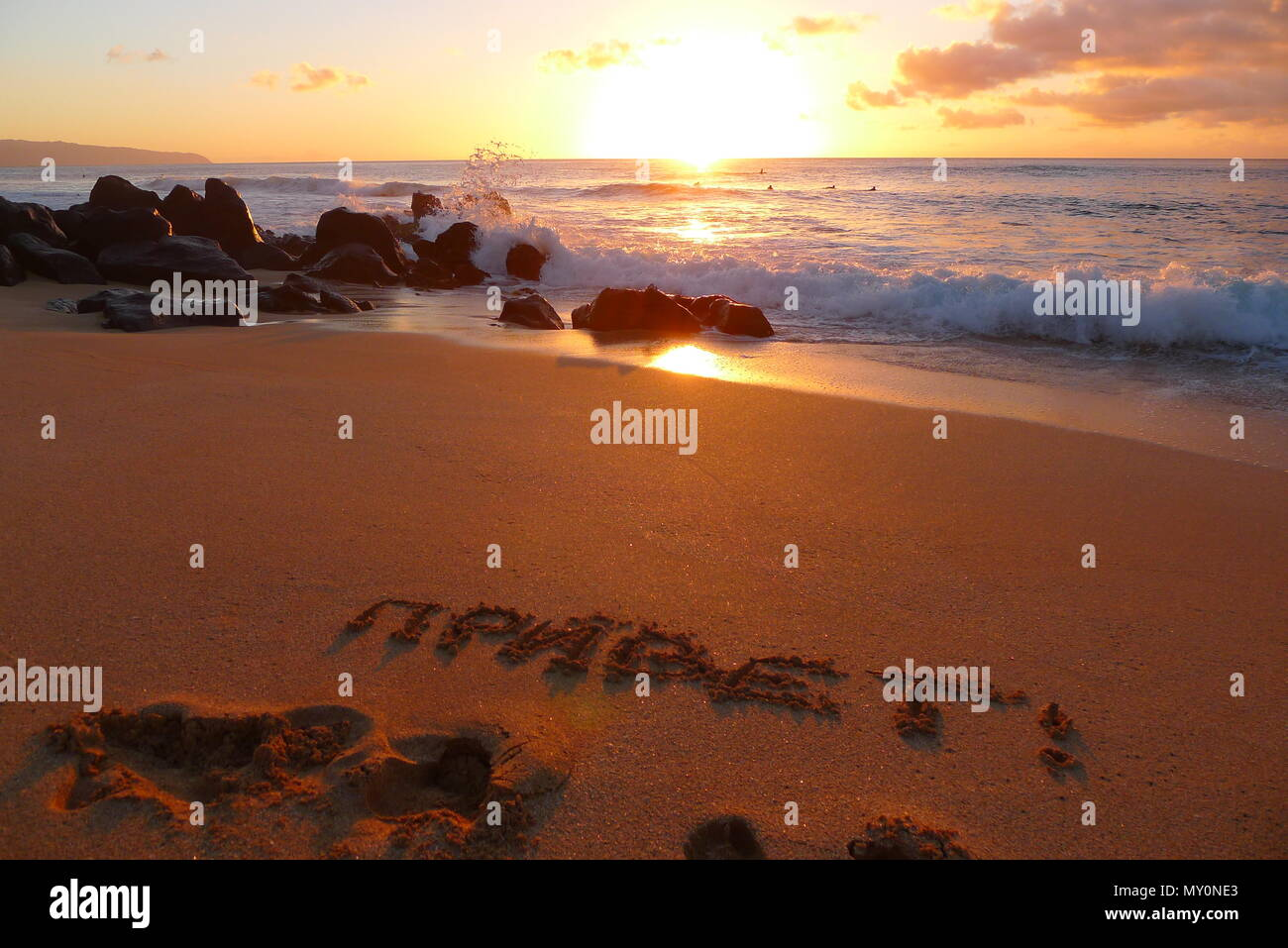 Beach At Hawaii With Greeting In Russian Letters In The Sand Stock