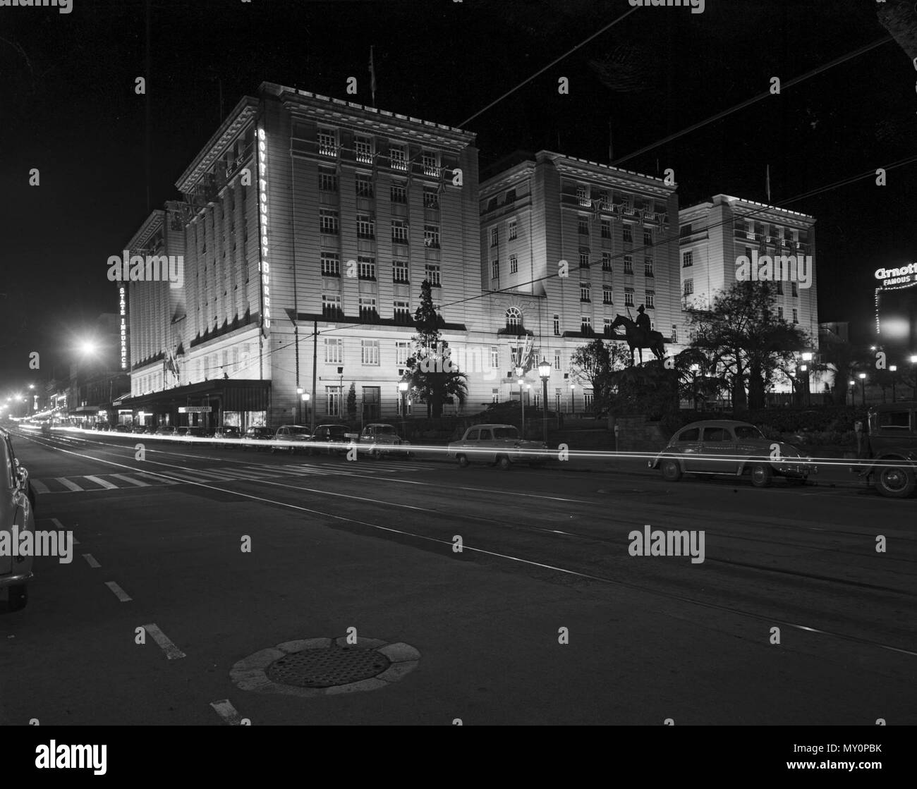 Queensland Government Offices, Ann Street, Brisbane, February 1958. The Queensland Government Offices (Anzac Square Building) were illuminated for the 1958 Royal Tour. The building was listed on the Queensland Heritage Registerid=600059 )  in 1992. - Stock Image