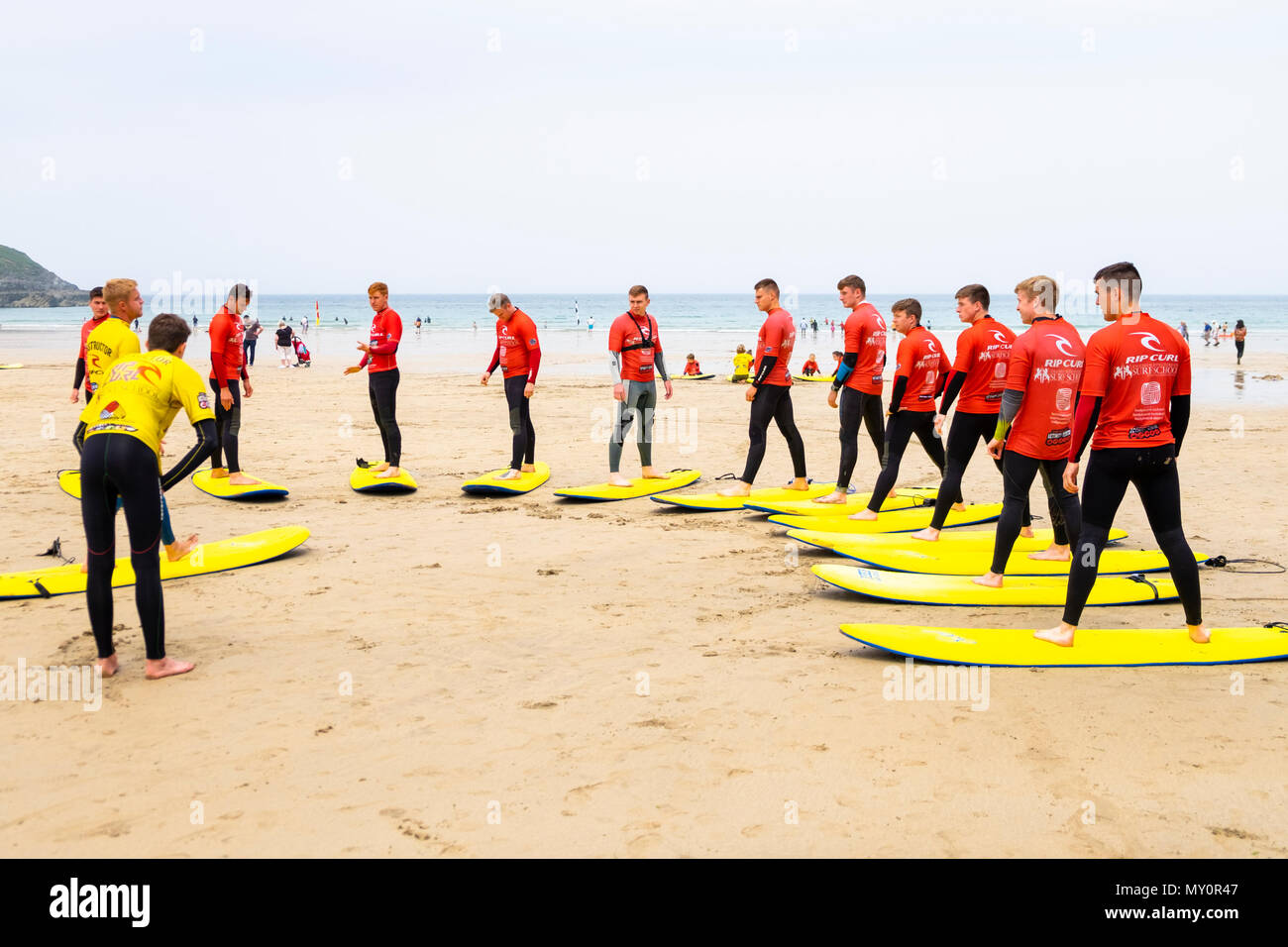 Surf school lessons on the fistral beach, newquay, cornwall, uk - Stock Image
