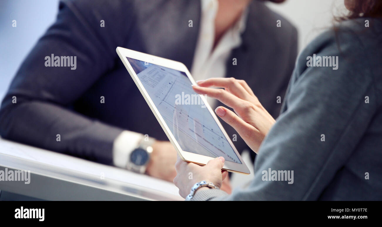 Close up picture of businessman using tablet - Stock Image