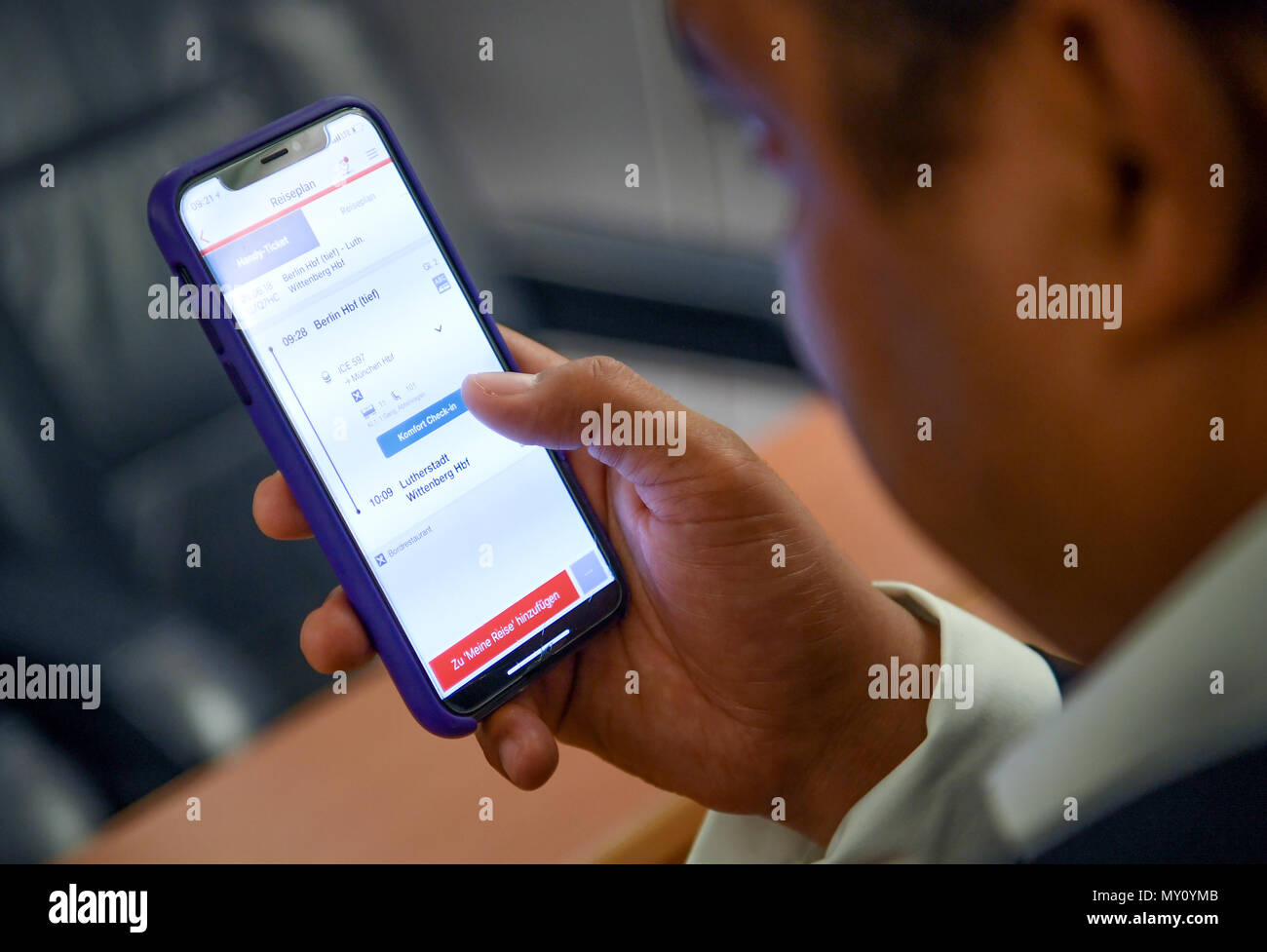 Berlin, Germany. 5th June, 2018.  A young man uses the app of the Deutsche Bahn 'DB Navigator' for the digital check-in in an ICE. Passengers with a phone ticket and a seat reservation are able to check in to the ICE on their own with the help of the app. So, the train attendants do not have to check the passenger for their ticket. Photo: Britta Pedersen/dpa Credit: dpa picture alliance/Alamy Live News - Stock Image
